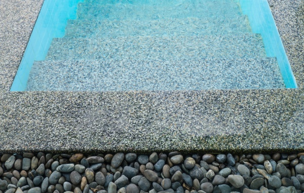 stone on the edge of the swimming pool